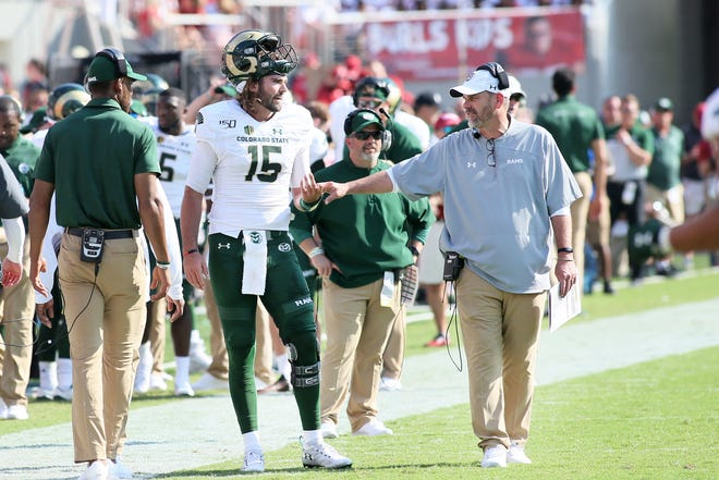 Colorado State quarterback Collin Hill is congratulated by coach Mike Bobo after scoring a touchdown in a Sept. 14, 2019, game at Arkansas. Hill, who suffered a season-ending knee injury later in that game, said Saturday that he is transferring to South Carolina, where Bobo is the new offensive coordinator, to complete his college football career.