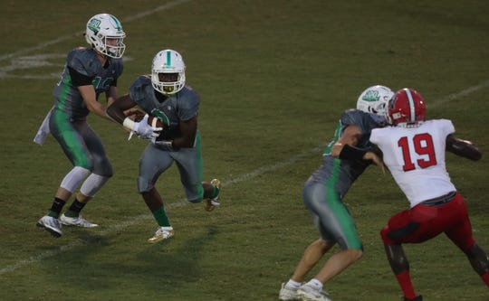 Game action between Fort Myers and North Fort Myers on Friday at Edison Stadium in Fort Myers. Fort Myers beat North 48-3.