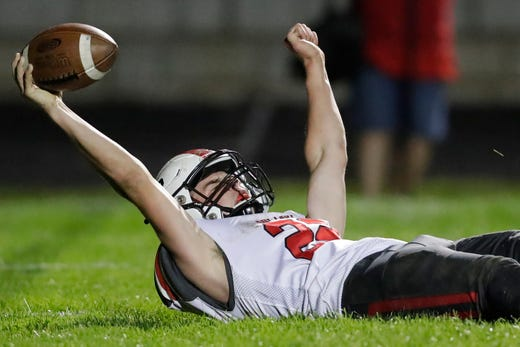 Pulaski's Benjamin Redlin (22) reacts after running for a touchdown against Green Bay Preble during their football game Friday, September 13, 2019, at Green Bay Preble High School in Green Bay, Wis.