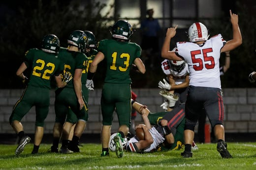 Pulaski's Benjamin Redlin (22) makes into the end zone for a touchdown against Green Bay Preble during their football game Friday, September 13, 2019, at Green Bay Preble High School in Green Bay, Wis.