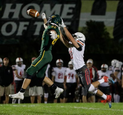 Pulaski's Brock Egnarski (11) breaks up a pass intended for Green Bay Preble's Nathan Vanseth (82) during their football game Friday, September 13, 2019, at Green Bay Preble High School in Green Bay, Wis.
