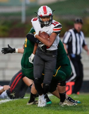 Pulaski's Joseph Oleary (18) runs the ball against Green Bay Preble during their football game Friday, September 13, 2019, at Green Bay Preble High School in Green Bay, Wis.