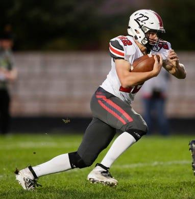 Pulaski's Benjamin Redlin (22) runs the ball against Green Bay Preble during their football game Friday, September 13, 2019, at Green Bay Preble High School in Green Bay, Wis.