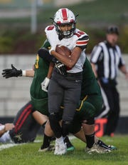 Pulaski's Joseph Oleary (18) runs the ball against Green Bay Preble on Friday. Oleary had a 5-yard touchdown run in the third quarter.