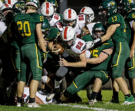 Pulaski's Benjamin Redlin (22) punches it over the goal line for a touchdown against Green Bay Preble during their football game Friday, September 13, 2019, at Green Bay Preble High School in Green Bay, Wis.