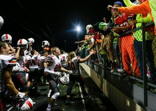 Pulaski's football team rushes to the stands to celebrate with the Pulaski student section after defeating Green Bay Treble 31-0 during their football game Friday, September 13, 2019, at Green Bay Preble High School in Green Bay, Wis.