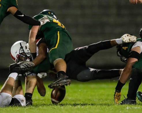 Green Bay Preble's Aiden Arquette (46) causes Pulaski's Joseph Oleary (18) to fumble for a turnover during their football game Friday, September 13, 2019, at Green Bay Preble High School in Green Bay, Wis.