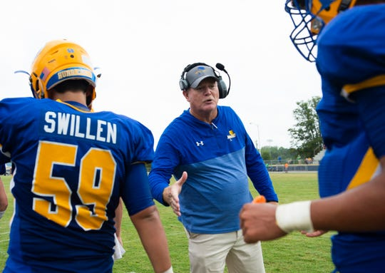 Wren Head Coach Jeff Tate slaps hands with player after a play during the game against Easley High School at Wren Saturday, Sept. 14, 2019.