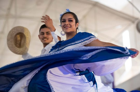 Karen Flores-Hernandez, 18, performs with the International Dance Academy in Greenville during the Hispanic Heritage Festival held by Asociación Hispano-Americana de Mujeres (AHAM) at McAlister Square Saturday, Sept. 14, 2019.
