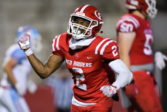 Greenville's Khalique Holland (2) reacts after scoring a touchdown during their game against J.L. Mann Friday.