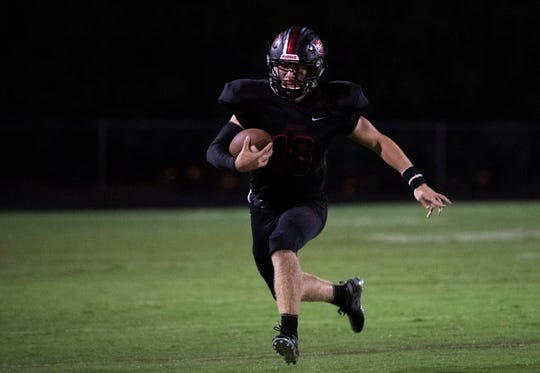 Hillcrest's Ethan Beamish (16) carries the ball during the game against Laurens Friday, Sept. 13, 2019.