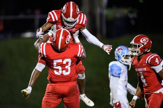 Greenville's Khalique Holland (2) is lifted up by teammate Baron Franks II (53) after he scored a touchdown in the second quarter of their game against J.L. Mann Friday Sept. 13, 2019.