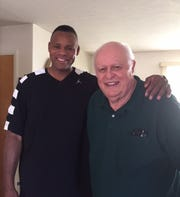 Former CMR athlete and Frontier Conference basketball star Kevin Evans and former CMR track coach Ron Frost share a moment and some memories.
