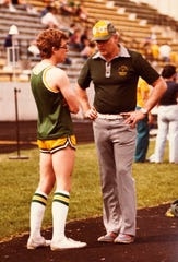 Former CMR boys' track coach Ron Frost, right, in 1980 with Rustler athlete Mark Pidcock going over the techniques he should be using.