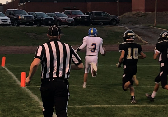 Great Falls Central's Shane Girres finishes up on a 45-yard touchdown run late in the first quarter of the Mustangs' 49-8 win over Cascade Friday night at Forzley-Perrine Field in Cascade.