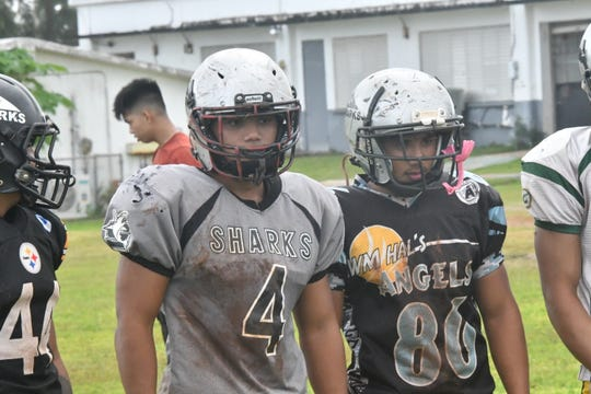 Sablan brothers Jeremiah, left and Jon watch the action during practice Sept. 11 at Simon Sanchez High School.
