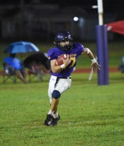 George Washington's Eian Naputi carries the ball on a kickoff return against the Southern High Dolphins in their IIAAG High School football regular season matchup at the George Washington High School Field, Mangilao, Sept. 14, 2019.