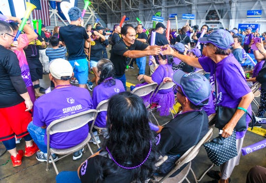 LeoPalace Resort employees present beaded necklaces to cancer survivors during the 14th Annual United Plane Pull fundraiser in Tiyan in this Sept. 14, 2019, file photo.