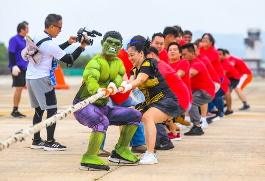 Food and beverage server, Lino Mathias, dresses as the superhero, Hulk, as he an fellow Guam Reef & Olive Spa Resort employees call upon their inner strength to move an United Boeing 737 passenger jetliner during the 14th Annual United Plane Pull fundraiser in Tiyan on Saturday, Sept. 14, 2019. The annual event, organized and sponsored by United employees, was held to raise funds to support the American Cancer Society and Guam Cancer Care.