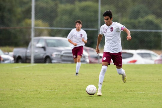 Henderson County's David Gonzalez (10) drives the ball down field during the Colonel Classic Henderson County vs Cooper game Saturday, Sept. 14, 2019.