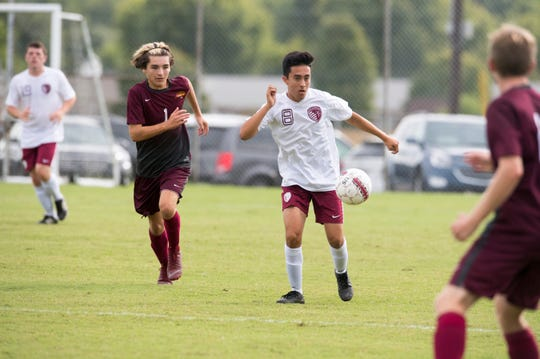 Henderson County's Juan Buritica (8) drives the ball down field during the Colonel Classic Henderson County vs Cooper game Saturday, Sept. 14, 2019.