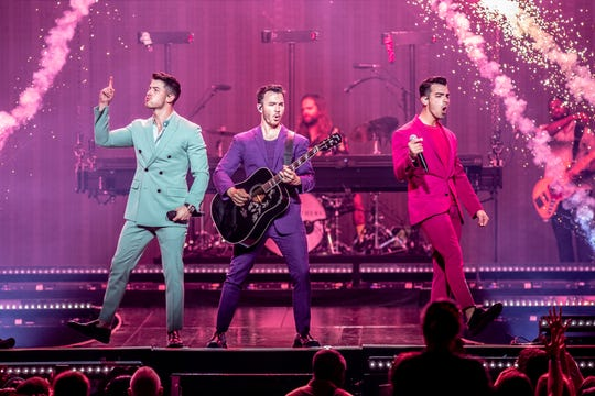 The Jonas Brothers, Nick, Kevin, and Joe, at Bankers Life Fieldhouse in Indianapolis, on Friday, Sept. 13, 2019.