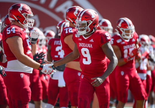 Indiana Hoosiers quarterback Michael Penix Jr. (9) high fives teammates during warmups prior to the start of the game against Ohio State at Memorial Stadium in Bloomington, Ind., on Saturday, Sept. 14, 2019.