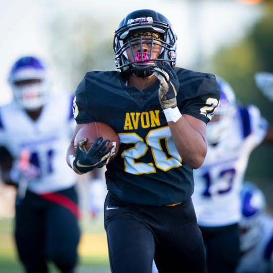 Avon High School senior Jalen Love (20) breaks through the Brownsburg defense for a long run up the sideline during the first half of action Sept. 13, 2019.