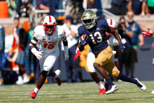 Notre Dame's Lawrence Keys III (13) returns the opening kickoff in the first half of an NCAA college football game against New Mexico in South Bend, Ind., Saturday, Sept. 14, 2019. (AP Photo/Paul Sancya)