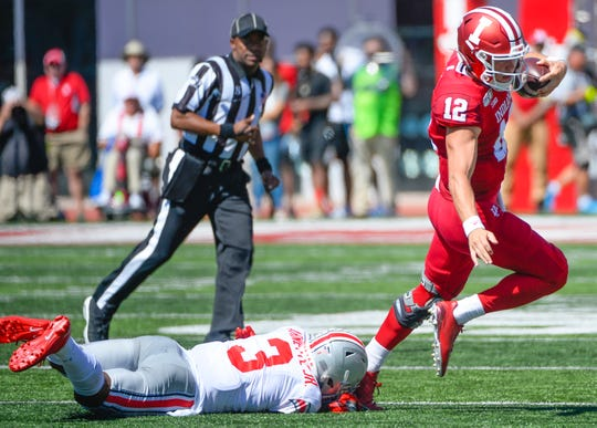 Indiana quarterback Peyton Ramsey tries to evade a tackle against Ohio State at Memorial Stadium in Bloomington, Ind., on Sept. 14, 2019.