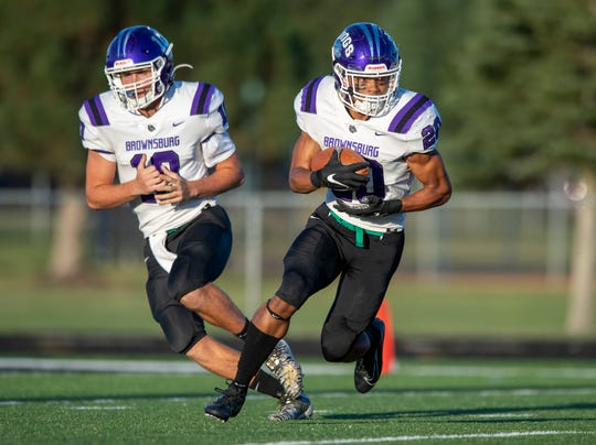 Brownsburg's Donny Marcus (right) and Ben Easters (left) led a high-powered Bulldogs offense past Zionsville on Friday night.