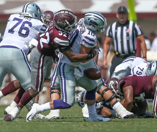 Mississippi State's Brian Cole II (32) hits Kansas State's Skylar Thompson (10) and forces a fumble in a college football game on Sept. 14, 2019, at Davis Wade Stadium in Starkville, Mississippi.