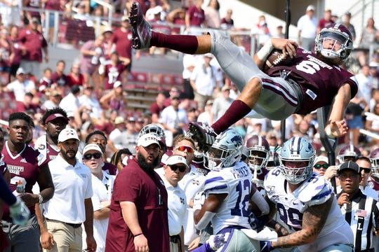 Sep 14, 2019; Starkville, MS, USA; Mississippi State Bulldogs quarterback Garrett Shrader (6) falls after being lofted into the air against the Kansas State Wildcats during the fourth quarter at Davis Wade Stadium. Mandatory Credit: Matt Bush-USA TODAY Sports