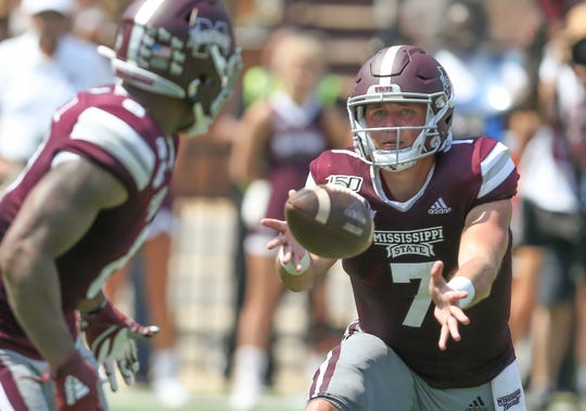 Mississippi State's Tommy Stevens (7) tosses the ball to Mississippi State's Kylin Hill (8). Mississippi State and Kansas State played in a college football game on Saturday, September 14, 2019 at Davis Wade Stadium in Starkville. Photo by Keith Warren
