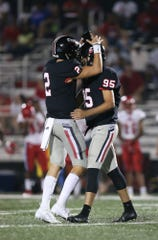 Brandon High School's Will Rogers (2) congratulates Brandon High School's Mason Walker (95) after he gave the Bulldogs the lead on a field goal. Brandon and Warren Central  played in an MHSAA Class 6A football game in Brandon on Friday, September 13, 2019. Photo by Keith Warren