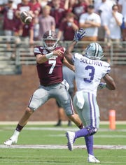 Mississippi State quarterback Tommy Stevens (7) releases a pass as Kansas State's Elijah Sullivan (3) defends.