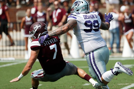 Mississippi State quarterback Tommy Stevens (7) is sacked by Kansas State Trey Dishon (99) during the first half of their NCAA college football game in Starkville, Miss., Saturday, Sept. 14, 2019. (AP Photo/Rogelio V. Solis)
