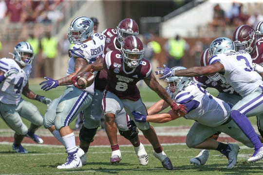 Mississippi State's Kylin Hill (8) breaks through the Kansas State line. Mississippi State and Kansas State played in a college football game on Saturday, September 14, 2019 at Davis Wade Stadium in Starkville. Photo by Keith Warren