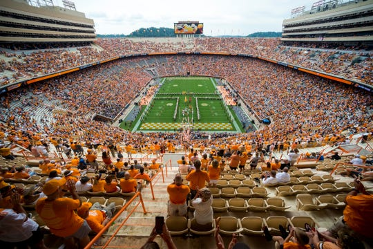 The Tennessee football team runs through the Power T before the Vols' home game against Chattanooga in Neyland Stadium in Knoxville on Saturday, Sept. 14, 2019.