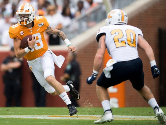 Tennessee quarterback Brian Maurer (18) runs the ball during Tennessee's home game against Chattanooga in Neyland Stadium in Knoxville on Saturday, Sept. 14, 2019.