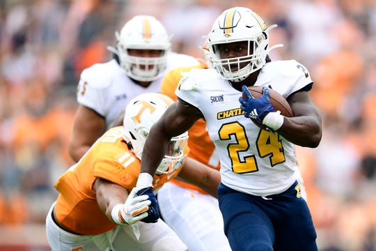 Chattanooga running back Elijah   Ibitokun-Hanks (24) runs down the field as Tennessee linebacker Henry To'o To'o (11) defends during a game between Tennessee and Chattanooga at Neyland Stadium in Knoxville, Tennessee on Saturday, September 14, 2019.
