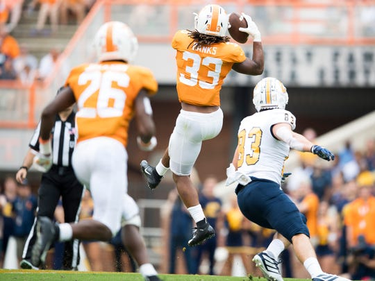 Former Tennessee football player Jeremy Banks (33) makes the interception during Tennessee's home game against Chattanooga in Neyland Stadium in Knoxville on Sept. 14.