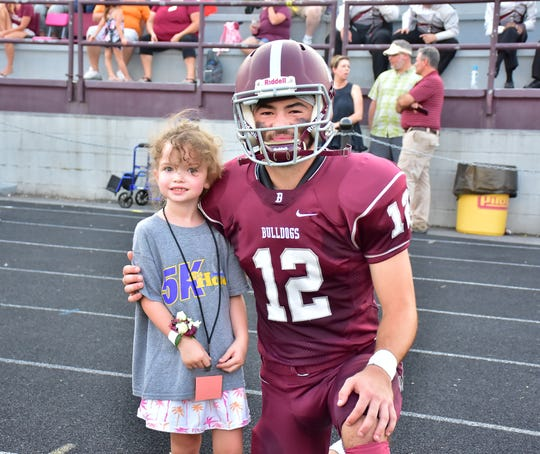 Tillery Phillips is welcomed to the field at Bearden High School by senior kicker Connor Cross on Friday, Sept. 13, 2019. Tillery served as honorary captain for the night alongside Cross and the other team captains. The 6-year-old met him last season when Cross began kicking to raise money for Alex's Lemonade Stand against childhood cancer.