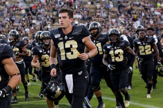 Purdue quarterback Jack Plummer (13) jogs off the field prior to a NCAA football game between the Purdue Boilermakers and the Texas Christian University Horned Frogs, Saturday, Sept. 14, 2019 in West Lafayette.