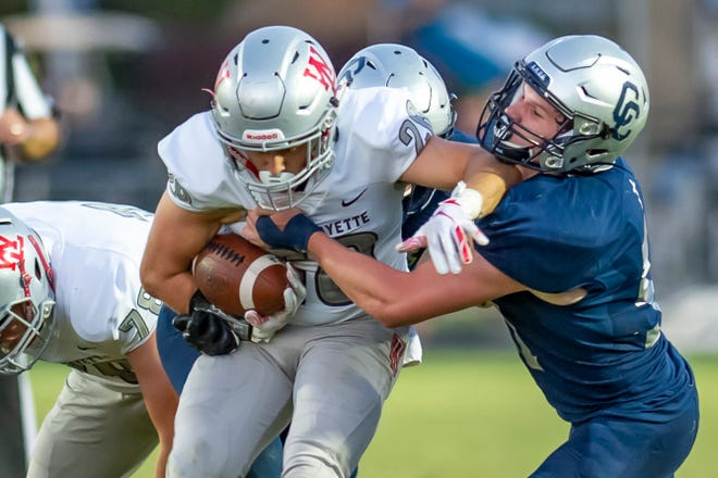West Lafayette's Spencer Blankman tries to break a tackle against Central Catholic.