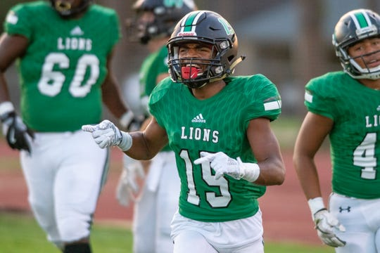 Lafayette High's Franshanseke Bellard (15) celebrates after his score as the Lafayette High Mighty Lions take on the St. Martinville Tigers on Friday, Sept. 13, 2019.