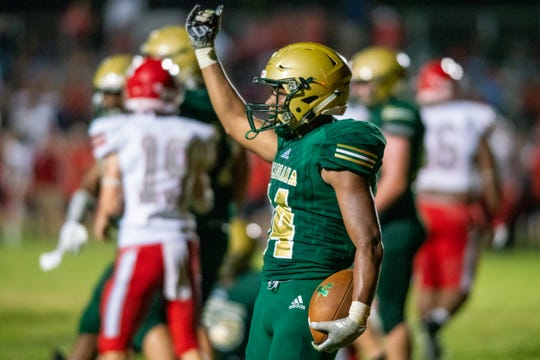Acadiana High's Tyvin Zeno celebrates his touchdown as the Acadiana Wreckin' Rams take on the Ruston Bearcats on Friday, Sept. 13, 2019.