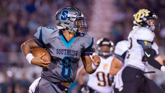 Southside quarterback Dillion Monette runs the ball against Church Point on Friday.