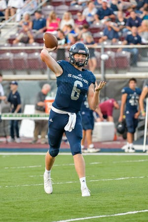 Caleb Holstein throws a pass  as the St Thomas More Cougars host Barbe. Sept. 13, 2019.