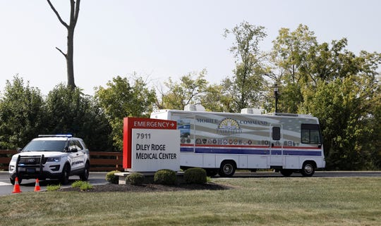 The Fairfield County Emergency Management Agency's mobile command unit enters Diley Ridge Medical Center Friday afternoon, Sept. 13 2019, in Canal Winchester. Firefighters and law enforcement officers were called to the center's emergency room Friday morning after a pickup truck was driven through the facility's doors. One person died in the incident.